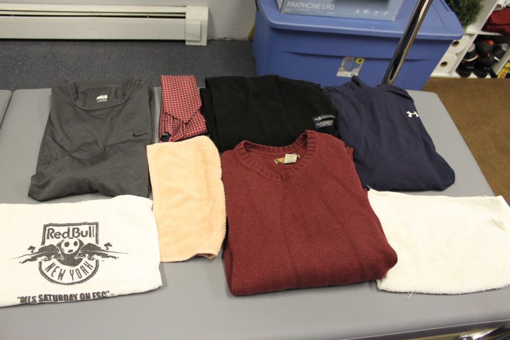 Nike Dry Fit Grey Short Sleeve, Red Tie, Black Polo Scarf, Long Sleeve Blue Under Armour, Three towels, Red Bass Sweater.