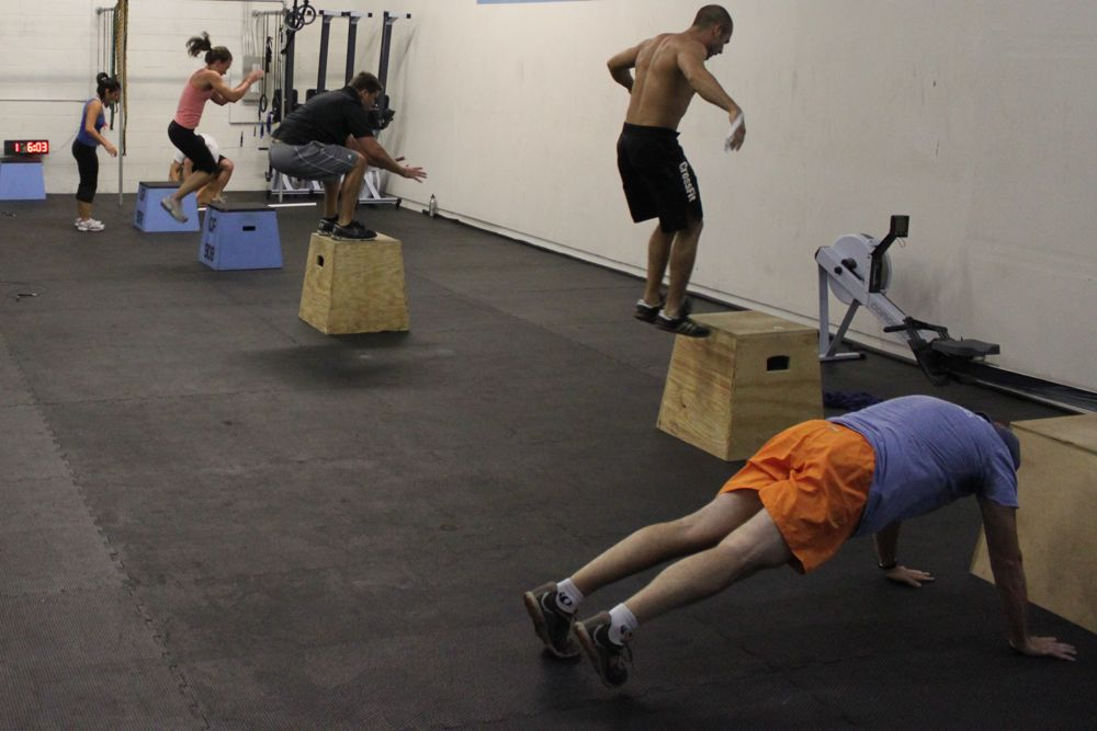 All different stages of the burpee box jump