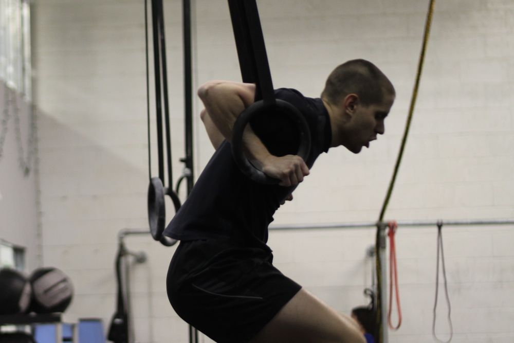 Andrew mid-muscle up. Good luck in Cali Andrew!