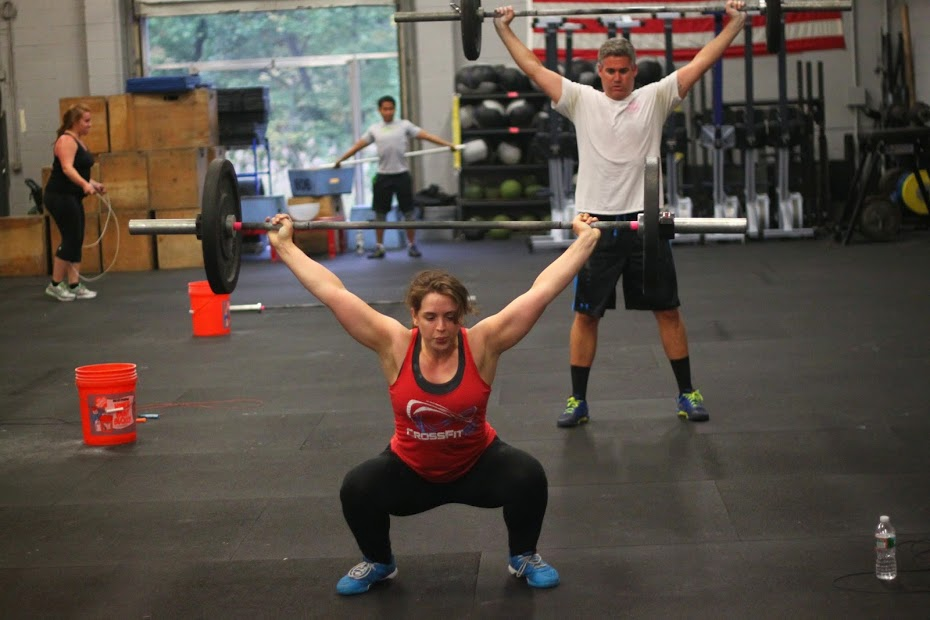 Bridget and Vinny working on overhead squats